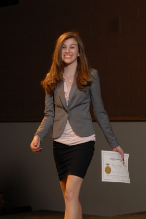 Scholastic Writing Awards participant walks off the stage after receiving her Gold Key certificate.