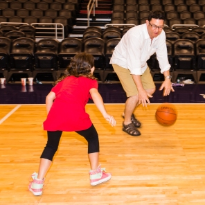 Parent David Pegram plays hoops with his daughter to support Arizona language and media arts.